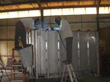 Welders Working On Silver Dump Bed