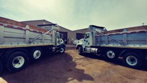Two Concord Road Equipment Trucks In Lot