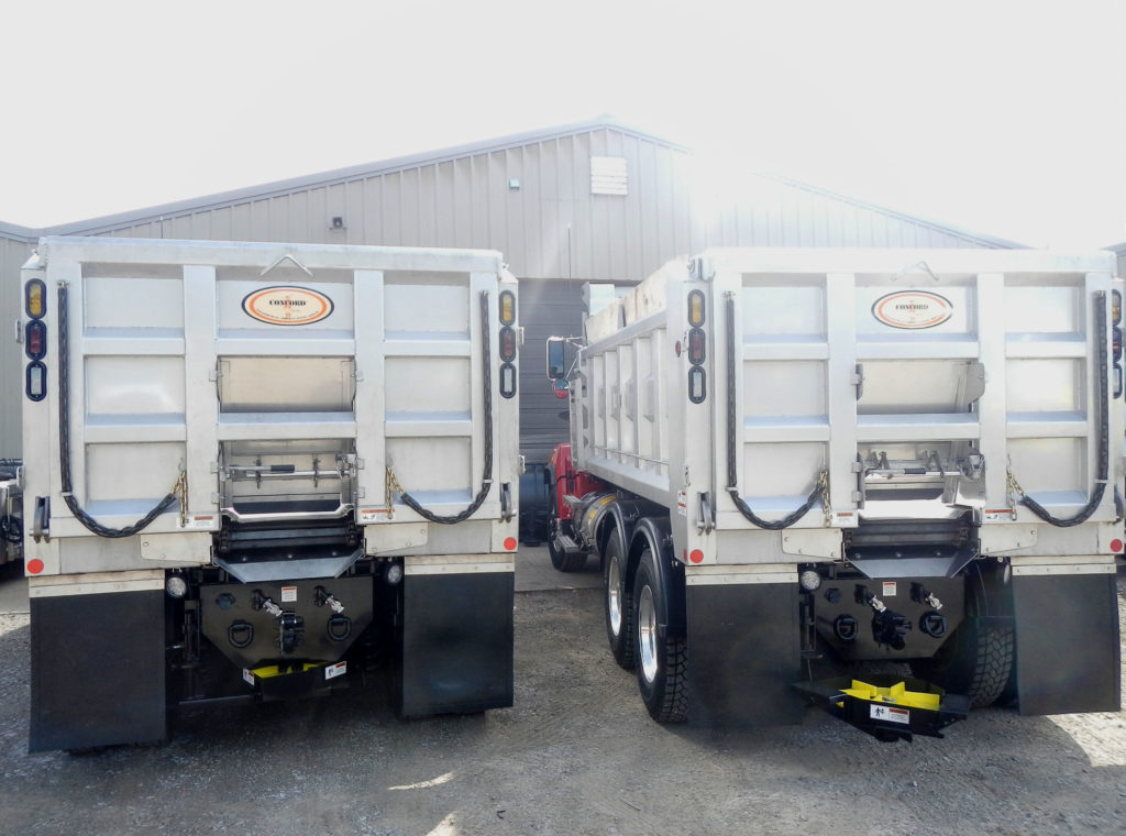 Two Concord Road Equipment Trucks Rear View