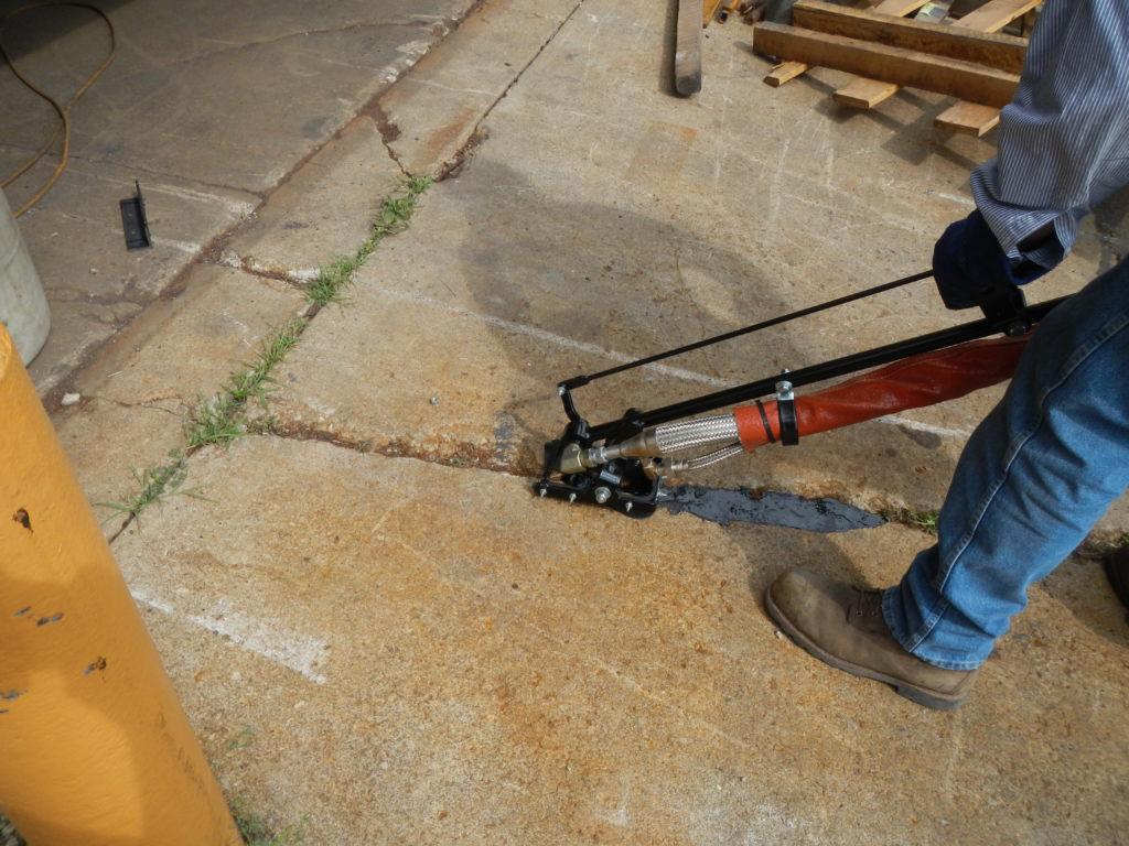 Worker Sealing Cement Crack