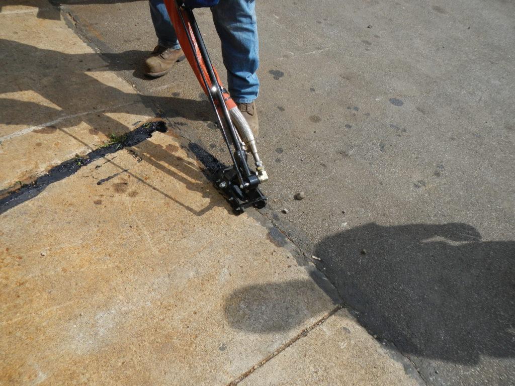 Working Sealing Crack In Sidewalk