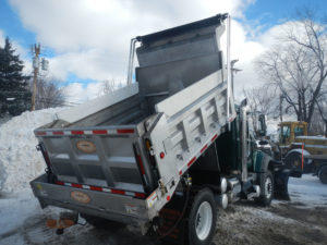 Concord Road Equipment Dump Body By Snow Pile In Brecksville