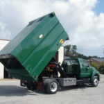 Concord Road Equipment Green Truck With Dump Bed Raised Rear Right