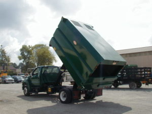 Concord Road Equipment Green Truck With Leaf Container Raised Left Rear