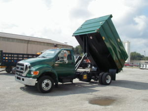 Concord Road Equipment Green Truck With Green Dump Bed Raised