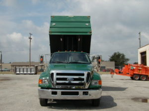 Concord Road Equipment Green Truck With Dump Bed Raised Front